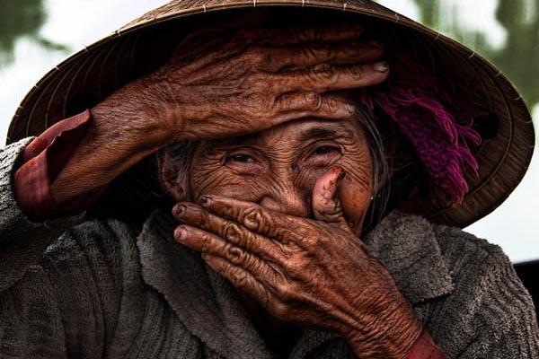 Красота вьетнамских жителей в серии фотографий «Скрытая улыбка»